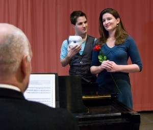 """Gabe Taylor, who plays the Phantom in Andrew Lloyd Webber's """"The Phantom of the Opera,"""" rehearses a duet with Laura Sparks, who plays the role of Christine Daae, to accompaniment by the director of the show, Douglas Brandt Byerly, chair of AACC's performing arts department. AACC is presenting the show through special arrangements with R&H Library. For information about tickets for the April production, visit http://www.aacc.edu/theater or contact the AACC Box Office, 410-777-2457 or mail to:boxoffice@aacc.edu."""