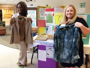 Professor Nicole R. Williams, Ph.D., coordinator of Anne Arundel Community College's Human Services programs and faculty advisor to AACC's Human Services Club, left, and student Ashley Auerbach of Calvert County display a few of the clothing items donated by members of the AACC community to Ruth's Miracle Group Home, a home for at-risk women. At Auerbach's suggestion, the club organized a campus-wide donation drive of clothing and toiletries for the women at the home to use as they transition into independent and self-sufficient lives.