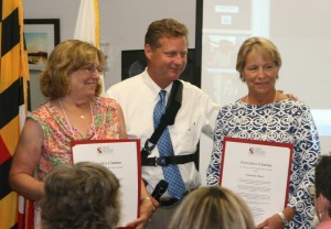 Yvonne Kranitz, County Executive Steve Schuh, and Susanne Boyle  being presented with County Executive citations for service on the Commission