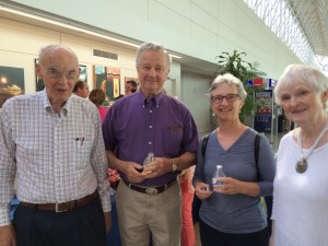 """Artists and art patrons Jim Earl, Jim Sayler, Terry Sayler and Sylvia Earl at the reception for the """"Reflections"""" exhibit at BWI AIrport."""