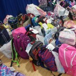 AACC donates 100 backpacks to Tyler Heights Elementary