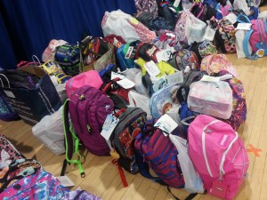 The backpacks line up along the floor of the cafeteria at Tyler Heights. Supplies were collected for students from pre-k through fifth grade.