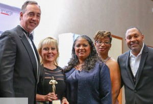 Anne Arundel Community College President Dr. Dawn Lindsay, second from left, received an Excellence in Academic Leadership Award at the inaugural Entrepreneurs Gala and Awards event Nov. 20. Standing with Dr. Lindsay are, from left, keynote speaker Wes Adams, State's Attorney for Anne Arundel County;  Carlesa Finney, vice chair of the event planning committee; Rebecca Blasingame-White, principal of Frank Hebron-Harmon Elementary School; and Larry White Sr., chief executive officer of VIPeVENTS Concierge, LLC, who organized the event. Proceeds benefited Women of Global Change, which supports women in becoming business owners and leaders in the community.