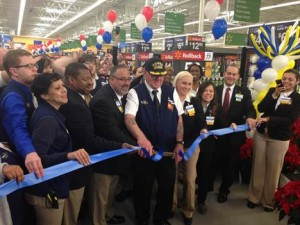 Walmart Store Manager Tony Atkinson (pictured middle, left) is joined by several of his store associates as the Pasadena location opens its doors to the community. To celebrate Veterans Day, one of Walmart's veterans at the Pasadena store cuts the ribbon.