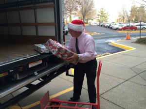 County  Executive Steve Schuh helps to load a truck for the Angel Tree program.